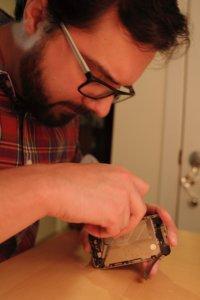 Jimmy repairing an iPhone 4
